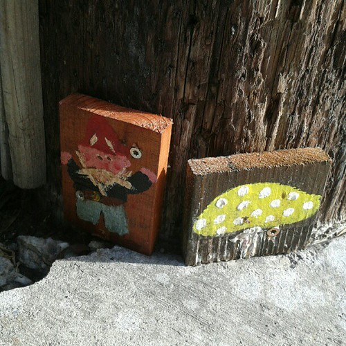 "Tons of these little gnome paintings can be found on telephone poles around Lake Merritt. PG&E wants to move them, calling the poles ""gnomes-man land"". #oakland"