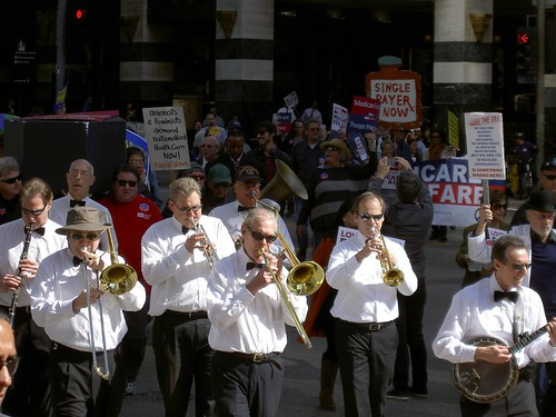 Brass band gets marchers in the mood.