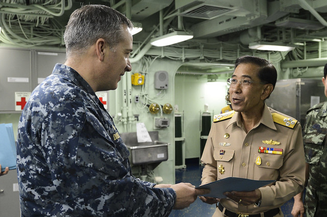 Capt. Daniel P. Dusek, ship's commanding officer, left, and Royal Thai Navy Adm. Thongpool Kanat, right
