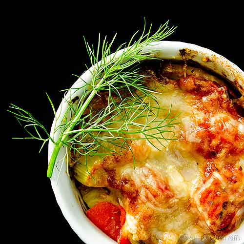 Fennel and Tomato Gratin in white ramekin, overhead view