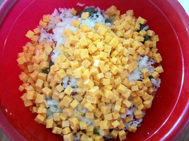 Cubed Cheddar Cheese Added to Salad