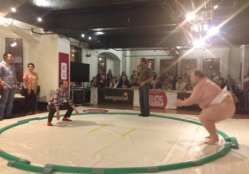 Sumo Wrestler Kelly and volunteer begin match