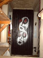 Graffiti in abandoned wooden villa
