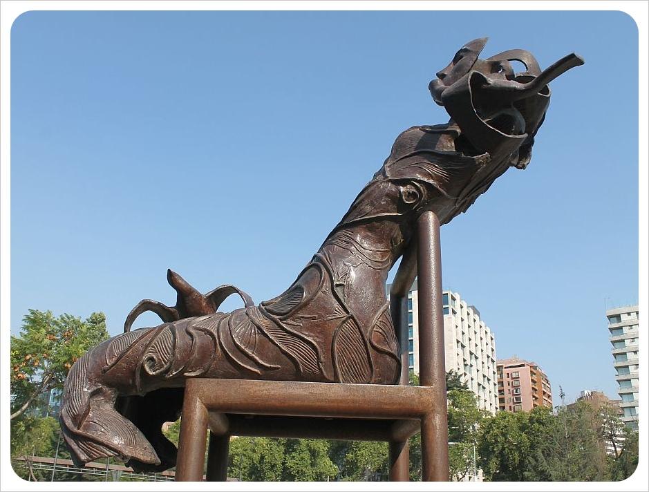 santiago sculpture woman in chair