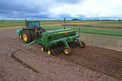 agriculture(1.0), farm(1.0), sowing(1.0), field(1.0), soil(1.0), vehicle(1.0), plough(1.0), agricultural machinery(1.0), crop(1.0), harvester(1.0), tractor(1.0),