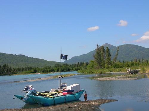Boat with the Kenai River in Alaska behind