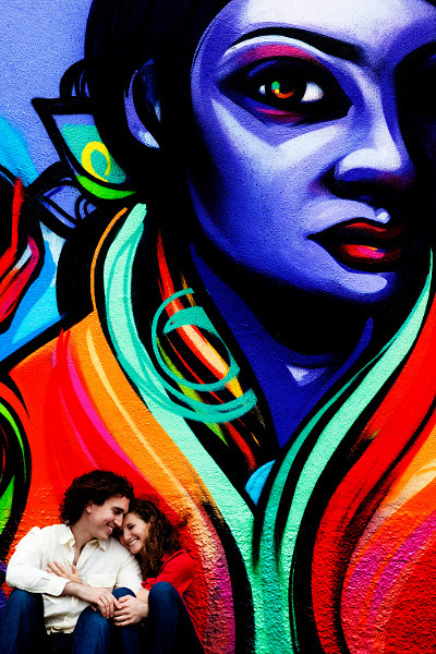 Rob and Lina in front of a mural in San Francisco