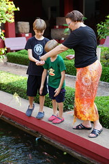Saurin, Micah, and Kate feeding fish