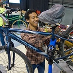 13-25 -- Alex Kim '12 works in the bicycle clinic at the Illinois Sustainable Living and Wellness Expo.