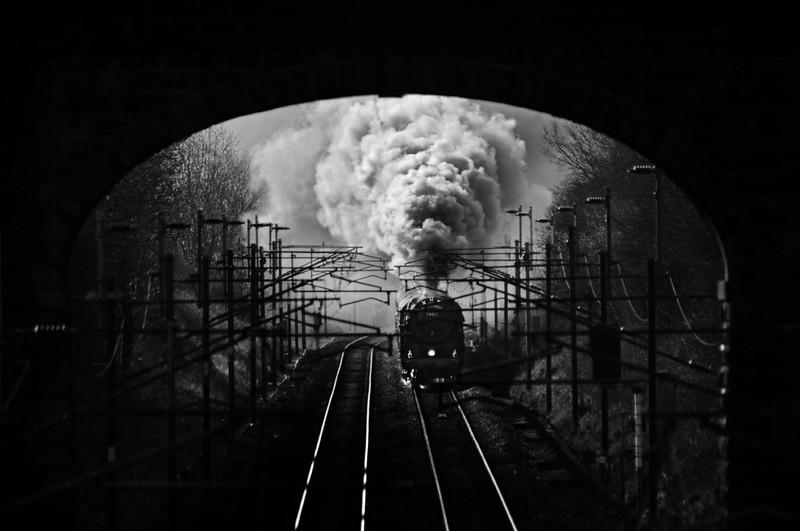 Steam Train approaching a tunnel