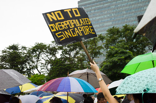 """A placard with the message from the people of Singapore to the ruling party - """"Say No to an Overpopulated Singapore"""""""