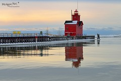 """Reflected Light"" Holland Harbor Lighthouse, known as (Big Red). by Michigan Nut"