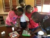 Boys using a laptop by Lubuto Library Project
