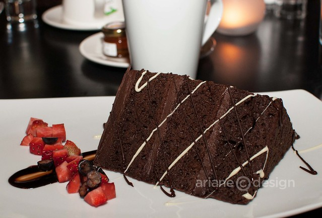 Mini Mosaic signature chocolate cake with fresh fruit and chocolate drizzle