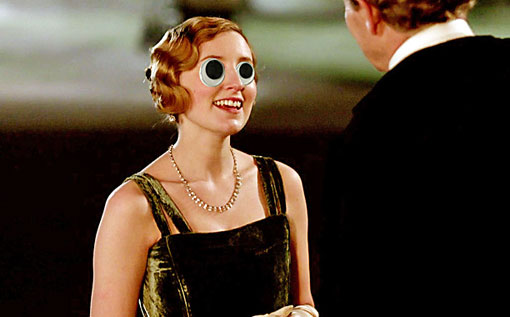 Lady Edith, wearing a fancy dress and absurd googly eyes