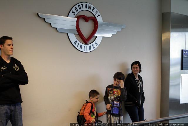 rachel putting her boys on a plane to see grandma neeta & grandpa jeff - _MG_3709