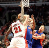 Chicago Bull Jimmy Butler blocks Detroit Piston Kyle Singler