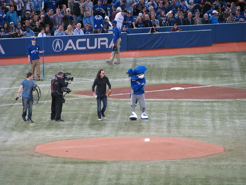 Geddy Lee throwing out First Pitch