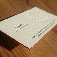 Photographer letterpress business card with red painted edges