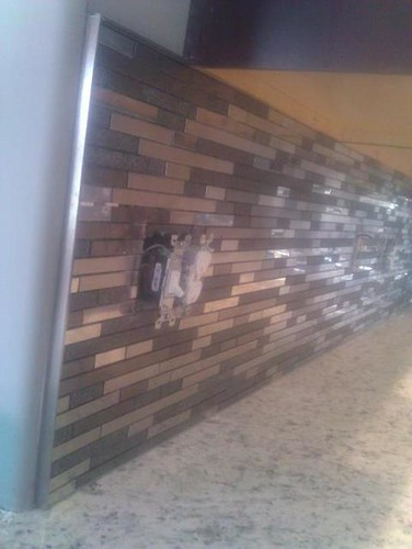 Granite and stainless steel backsplash