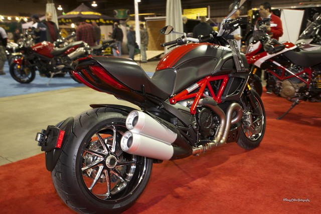 "Of all the new bikes on display at the 2013 Timonium Motorcycle this Ducati Diavel really caught my eye.. So…….Italian.  Not that I was shopping for a bike, but if I was?   © 2013 Doug Miller Photography  <a href=""http://www.dougmillerphotos.com"" rel=""nofollow"">www.dougmillerphotos.com</a>  <a href=""http://www.speedovision.com"" rel=""nofollow"">www.speedovision.com</a>"
