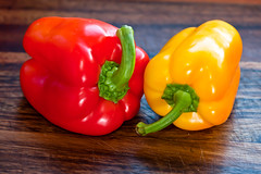 plant(0.0), peperoncini(0.0), habanero chili(0.0), paprika(1.0), chili pepper(1.0), bell pepper(1.0), vegetable(1.0), yellow pepper(1.0), red bell pepper(1.0), peppers(1.0), bell peppers and chili peppers(1.0), italian sweet pepper(1.0), produce(1.0), food(1.0), pimiento(1.0),