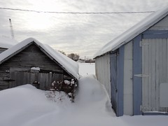 Peeking between the boathouses.