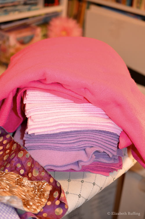 Pile of colorful fabrics, hot pink, pink, lavender, by Elizabeth Ruffing