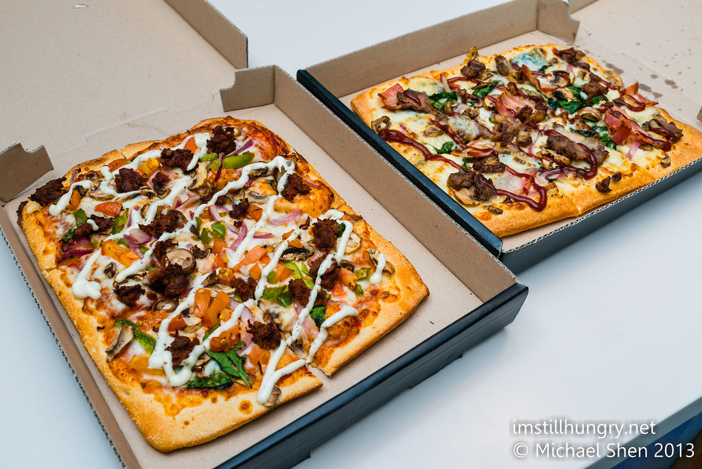 Domino's Chef's Best pizzas Left: Shiraz Lamb & Tomato w/mint yoghurt sauce Right: BBQ Duck & Blue Cheese w/BBQ sauce