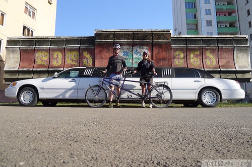 Tandem bicycle and a limousine in Georgia