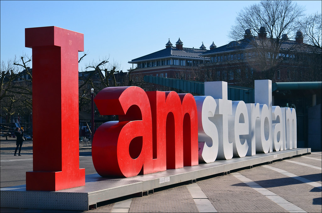 Modern marketing logo for the city of Amsterdam outside the Rijksmuseum.