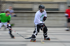 competition event(0.0), roller derby(0.0), bandy(0.0), stick and ball games(1.0), skating(1.0), roller sport(1.0), footwear(1.0), sports(1.0), roller in-line hockey(1.0), street sports(1.0), roller skating(1.0),