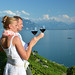 Man and woman tasting wine among vineyards in Lavaux, Switzerlan by Ark Relocation