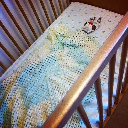 Spotty bunny tucked in LB's cot.