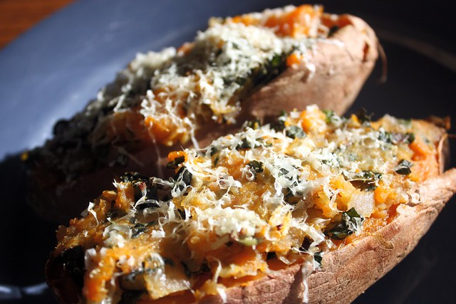Quinoa-stuffed sweet potatoes with kale and pumpkin seeds