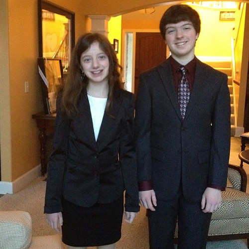 The kids all dressed up for Montessori Model United Nations. Chloe is a delegate for Burma. Ethan is on the dais.