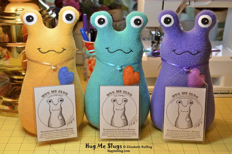 Gold, Teal, and Purple Hug Me Slugs, original stuffed animal art toys by Elizabeth Ruffing