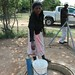 A woman fetches water from one of the few functioning water schemes in the rural community of Maphilingo, Swaziland. Credit: Mantoe Phakathi/IPS