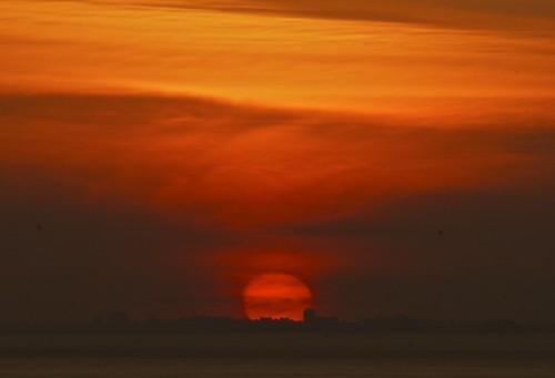 city sunset red orange cloud sun building set skyline ball fire cardiff outline