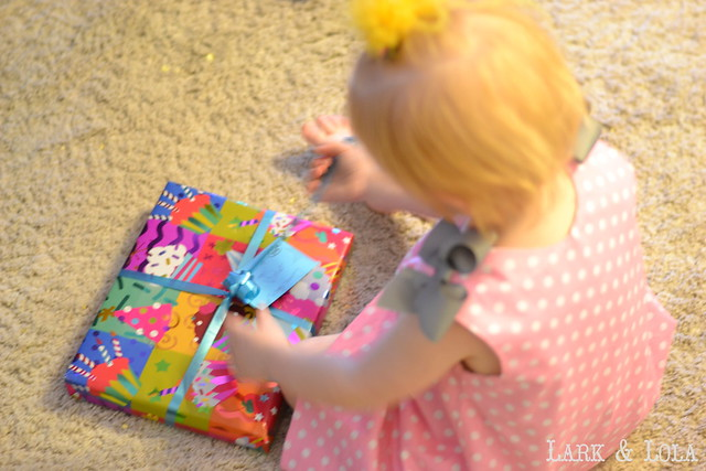 Violet opens gifts