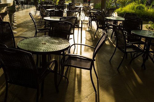 Sun lit tables and chairs at Gardens by the Bay
