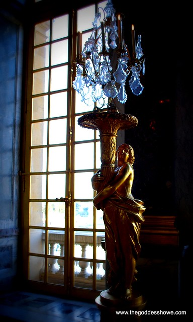 statue by a window at Versailles, France