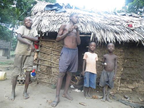 The children outside family house