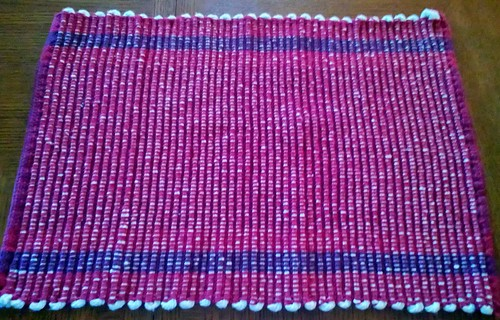 Placemat, hemmed, washed, dried.