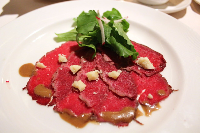 Beef Carpaccio with Arugula and Celeriac lemon extra virgin olive oil, shaved Marmigiano Reggiano and aged balsamic reduction
