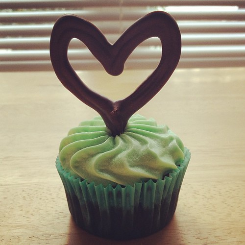 """Minted Love Cupcakes"" = chocolate cupcakes + mint chocolate ganache filling + vanilla mint cream cheese frosting + handmade chocolate heart topper."
