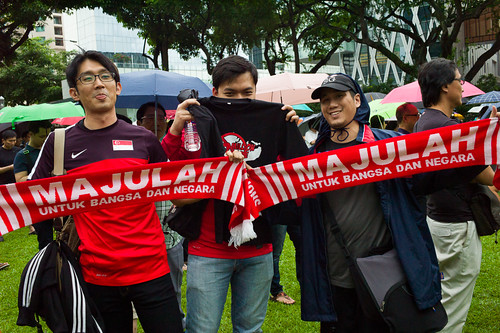 This group of guys wore jerseys emblazoned with the Singapore flag and carried Lions XII soccer team scarfs in support of the protest.