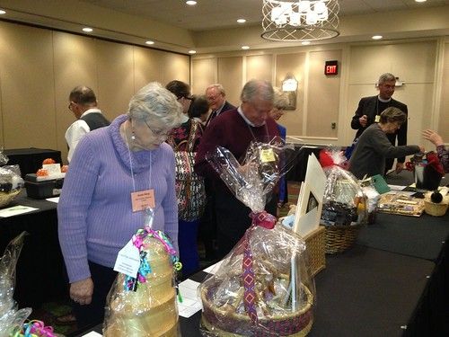 """<p>The silent auction to benefit the Diocesan Youth Commission included a hotly contested """"Justified"""" basket from Harlan -- complete with a bottle of moonshine.</p>"""