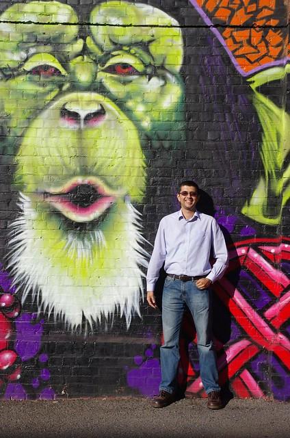 Neerav Bhatt standing in front of Adelaide street art