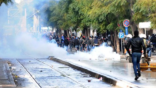 Police fire teargas at mourners after the funeral of Tunisian opposition activist Chokri Belaid. The funeral was attended by tens of thousands on Feb. 8, 2013. by Pan-African News Wire File Photos